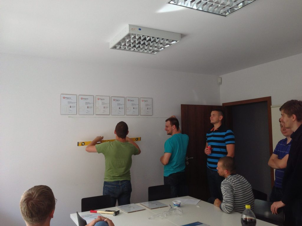Creatuity's Team Hangs Their Magento Certifications in the Office